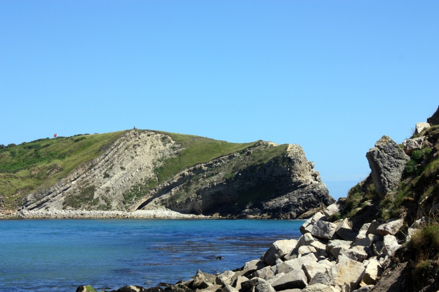 Layers of rock laid down overcountless  millenia at Lulworth cove